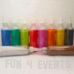 flesjes gekleurd zand