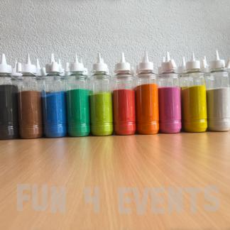 flessen gekleurd zand